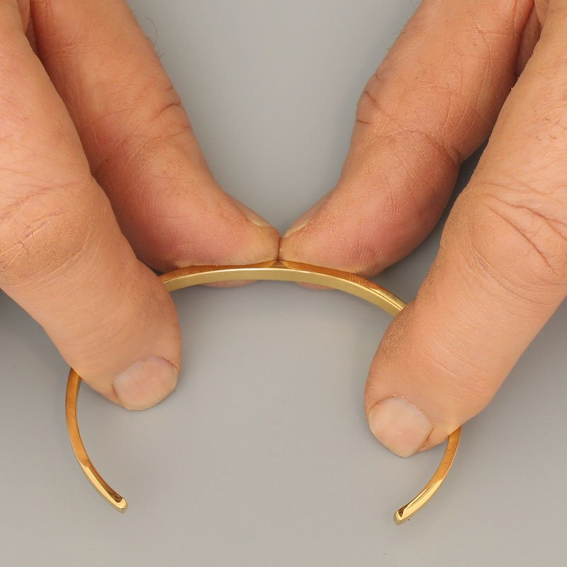Justare storlek metallarmband